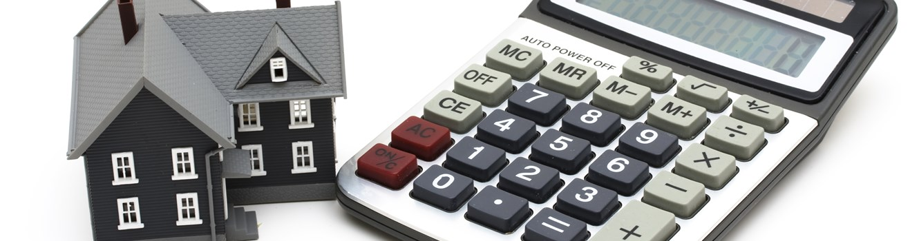 Shutterstock 10043680 1 Model House And Calculator
