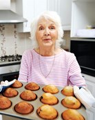 A lady is baking cakes