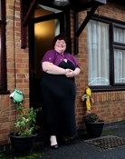Tenant Clare stands outside her Supported Living home