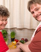 A woman and a man prepare a healthy meal