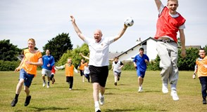 A community football team celebrate in Lytham